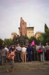 The crowd immediately targeted the large red granite Lenin statue