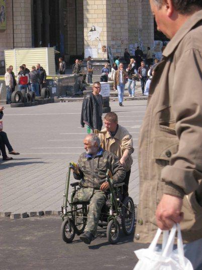 Veteran crosses maidan (Independence Square) Kyiv (Kiev) April 2014
