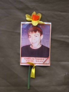 A picture on a tent on Khreshchatyk Street of one of the Heavenly Hundred who died in February 2014 fighting in Kyiv (Kiev)