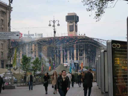Khreshchatyk and burned out Trades Union building in Kyiv April 2014